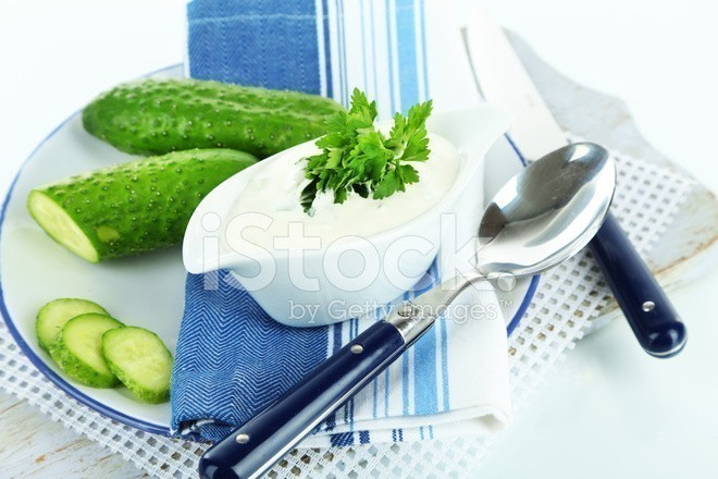54651664-cucumber-yogurt-in-sauceboat-on-color-napkin-isolated-on-white.jpg